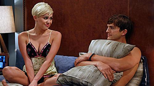 First Look: Miley Cozies Up To Ashton on 'Men'