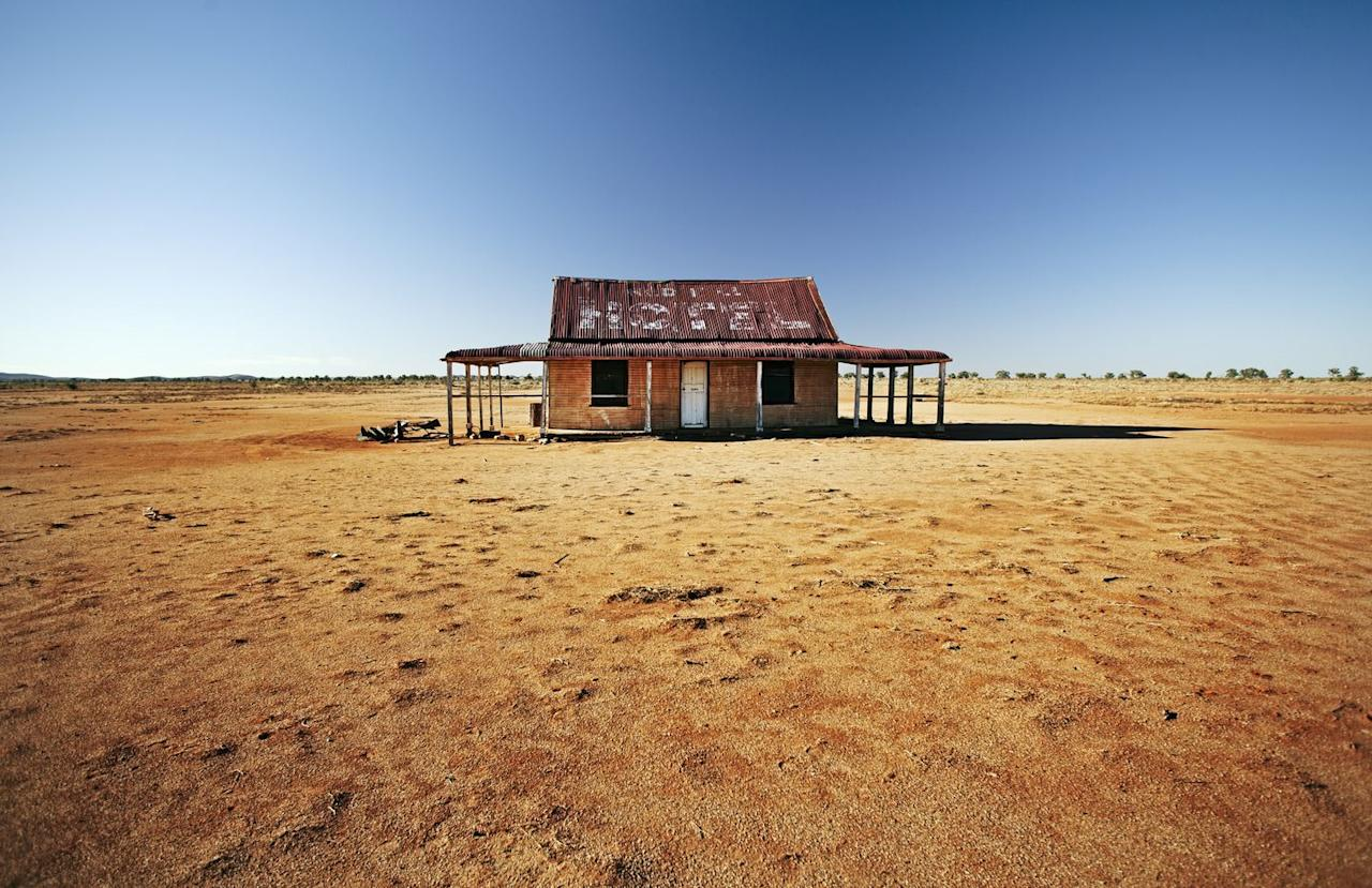 <p>An abandoned house sits in the middle of the desert.</p>
