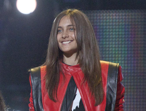 FILE - In this Oct. 8, 2011 file photo shows Paris Jackson on stage at the Michael Forever the Tribute Concert, at the Millennium Stadium in Cardiff, Wales. A judge overseeing a guardianship of Michael Jackson's children said Tuesday June 25, 2013, that he was making no changes to oversight of the children after receiving an investigator's report on their well-being and speaking with lawyers for their guardians, Katherine and TJ Jackson. (AP Photo/Joel Ryan, file)