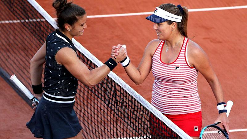 Maria Sakkari shakes hands with Anna Tatishvili. (Photo by Adam Pretty/Getty Images)