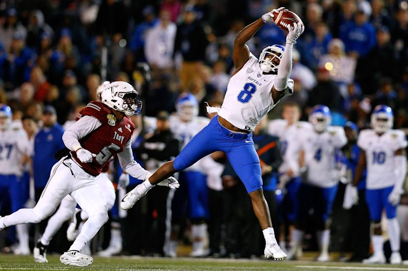 MOBILE, ALABAMA - DECEMBER 22: K.J. Osborn #8 of the Buffalo Bulls catches the ball as Cedarius Rookard #5 of the Troy Trojans defends during the first half of the Dollar General Bowl on December 22, 2018 in Mobile, Alabama. (Photo by Jonathan Bachman/Getty Images)