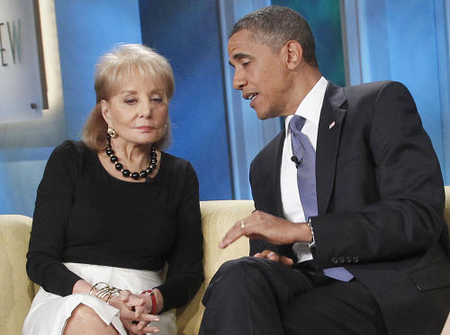 """FILE - In this July 28, 2010 file photo, President Barack Obama speaks to Barbara Walters during his guest appearance on ABC's '""""The View"""" in New York. Walters plans to retire next year, ending a television career that began more than a half century ago and made her a trailblazer in news and daytime TV. Someone who works closely with Walters says the plan is for her to retire in May 2014 after a series of special programs saluting her career. The person was not authorized to discuss the matter publicly and spoke to The Associated Press on Thursday, March 28, 2013 on condition of anonymity. (AP Photo/Pablo Martinez Monsivais, File)"""