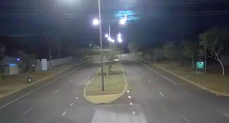 CCTV vision shows a mysterious flash of blue light in the sky above Alice Springs.