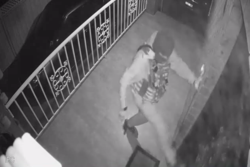 The gunman wearing a balaclava kicks the door of the Reservoir property while firing several bullets.