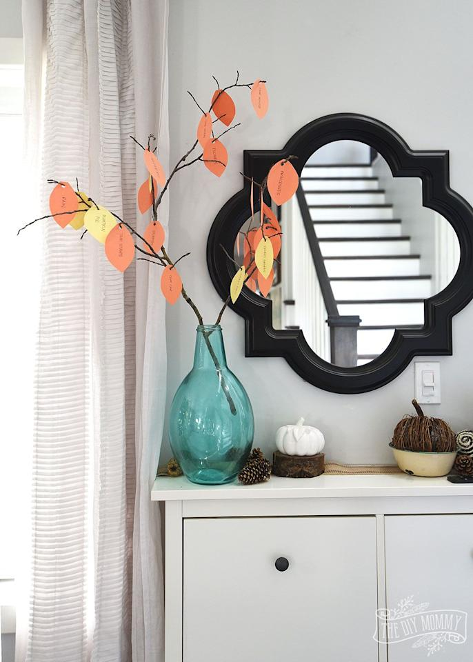 "<p>This one is simple enough to make with the kids during craft time, but is also great to display as a beautiful decor piece. All you'll need is a tree branch, some construction paper, a hole puncher and a glue gun — and of course a vase or pot to display your kids' handiwork with style.</p><p><em><a href=""https://thediymommy.com/make-a-thankful-tree-a-thankgiving-kids-craft/"" target=""_blank"">Get the tutorial at The DIY Mommy »</a></em></p><p><strong>RELATED: </strong><a href=""https://www.goodhousekeeping.com/holidays/thanksgiving-ideas/g2907/thanksgiving-kids-crafts/"" target=""_blank"">36 Easy Thanksgiving Crafts for Kids That'll Make Their Holiday More Fun</a></p>"