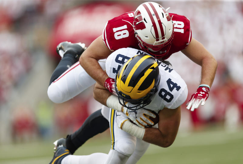 Wisconsin Badgers safety Collin Wilder (18) tackles Michigan Wolverines tight end Sean McKeon (84) during the third quarter on Sept. 21. (Getty)