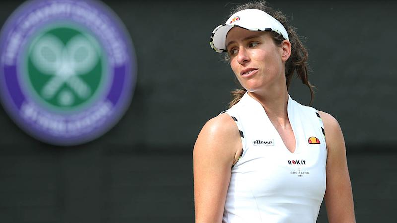 Johanna Konta reacts during her loss at Wimbledon. (Photo by Rob Newell - CameraSport via Getty Images)