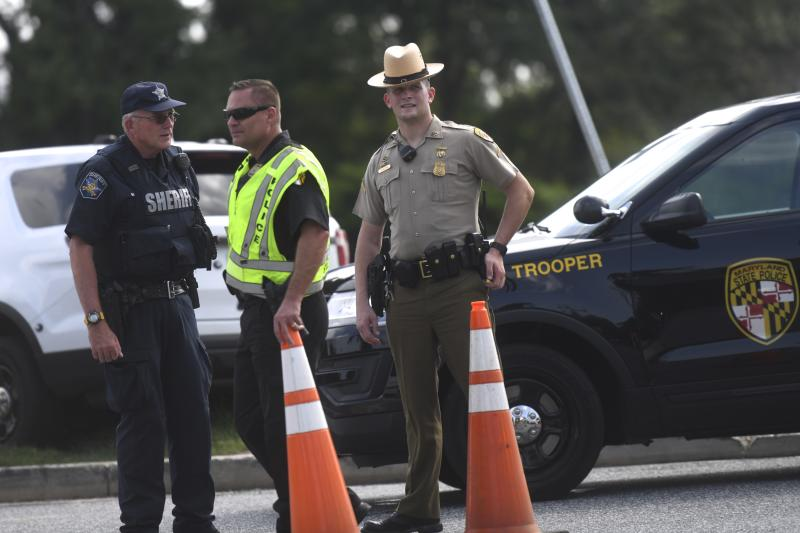Maryland shooting: Officers patrol the scene where the woman opened fire at a Aberdeen Rite Aid warehouse. Source: Getty