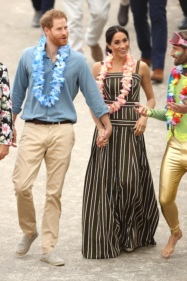 <p>Meghan Markle started the day in a a $1,615 stripped maxi dress from Paris-based Australian label Martin Grant, the same designer who made the trench coat she wore on Thursday and Tuesday. Photo: Getty </p>