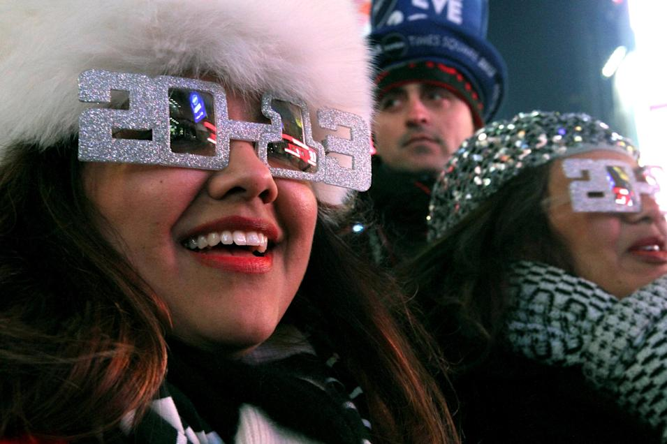 Alexandra Esquivel, left, and her aunt Anna Ramos, right, both from Arizona, attend the New Year's Eve festivities in New York's Times Square on Monday, Dec. 31, 2012. (AP Photo/Tina Fineberg)