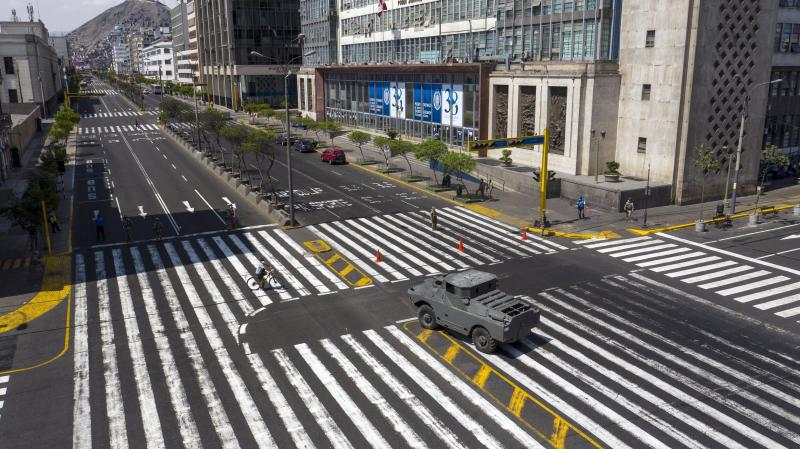 An armored vehicle guards an intersection on Abancay avenue, after the government implemented restrictions to prevent the spread of the new coronavirus in Lima, Peru, March 18, 2020. (AP Photo/Rodrigo Abd)