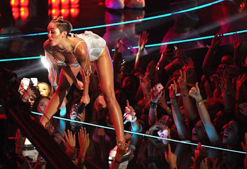 FILE - In this Aug. 25, 2013 file photo, Miley Cyrus performs at the MTV Video Music Awards at the Barclays Center in New York. Her infamous performance on the MTV Video Music Awards, showed her twerking her way in pop culture history in a teddy bear leotard that segues to a skimpy nude bikini. (Photo by Charles Sykes/Invision/AP, File)
