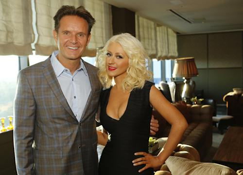 "This Wednesday, Sept. 18, 2013 photo released by NBC shows Executive Producer, Mark Burnett, left, and Christina Aguilera at an intimate dinner event for season five of ""The Voice"" in West Hollywood, Calif. Aguilera looks ever the confident, music megastar as she attends a press event at the trendy Soho House. NBC's ""The Voice"" premieres on Monday, September 23, 2013, at 8 pm. ET. (AP Photo/NBC, Trae Patton)"