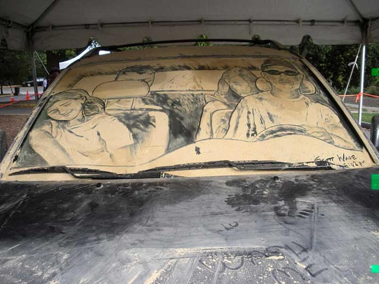 """The Atlanta Arts Festival was a lot of fun. I did an unusual piece suggested to me by my collegue, John McDavitt, featuring a family on vacation in their car, as seen from all sides. A family we're friends with kindly posed for the reference photos - Thanks Rick, Heather Austin & Haley!. This is the first time I've worked on a windshield. My back still hurts to think about it. """