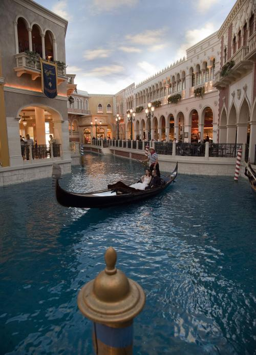 FILE- In this March 20, 2012, file photo, a gondolier serenades a couple as he steers the gondola through the canal inside the Venetian hotel-casino, in Las Vegas. The famous canals that meander through the Shoppes inside the resort have been drained for maintenance for several weeks. (AP Photo/Julie Jacobson, file)
