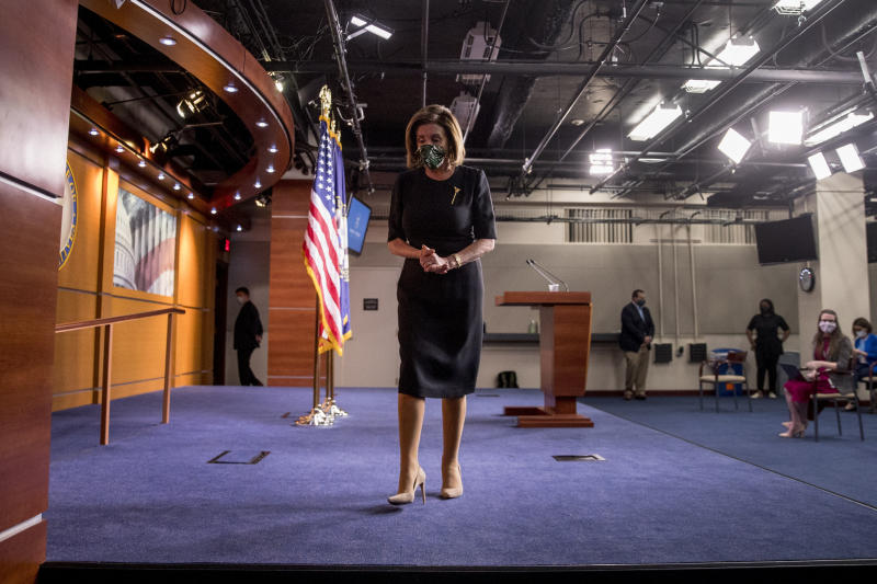 House Speaker Nancy Pelosi of Calif., wears a mask as she steps away from the podium at the conclusion of a news conference on Capitol Hill, Thursday, May 14, 2020, in Washington. (AP Photo/Andrew Harnik)