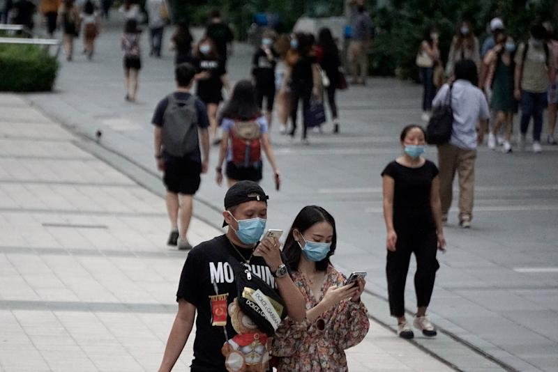 People in face masks seen along Orchard Road on 19 June 2020, the first day of Phase 2 of Singapore's re-opening. (PHOTO: Dhany Osman / Yahoo News Singapore)