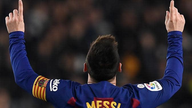 Bintang Barcelona Lionel Messi merayakan gol ke gawang Real Mallorca di Camp Nou, Sabtu (7/12/2019) atau Minggu dini hari WIB. (AFP/Josep Lago)