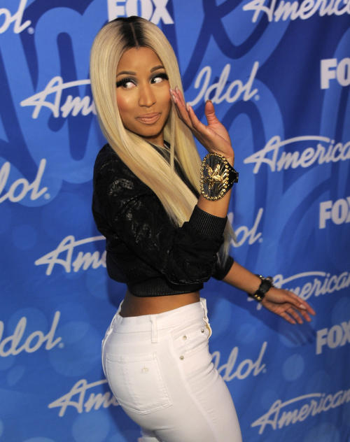 "FILE - This May 16, 2013 file photo shows singer and judge Nicki Minaj backstage at the ""American Idol"" finale in Los Angeles. Minaj is following Mariah Carey out of the door on ""American Idol."" The hip-hop diva announced Thursday on Twitter that it was ""time to focus on the music."" (Photo by Chris Pizzello/Invision/AP, file)"