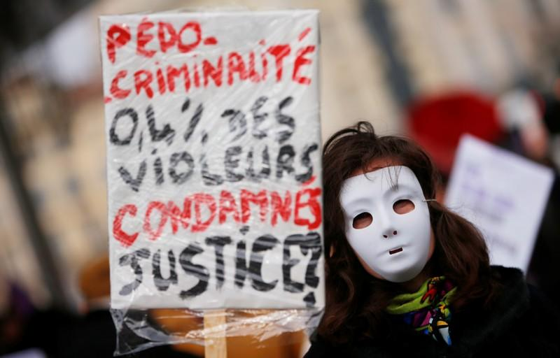 People attend a demonstration against femicide and violence against women in Marseill