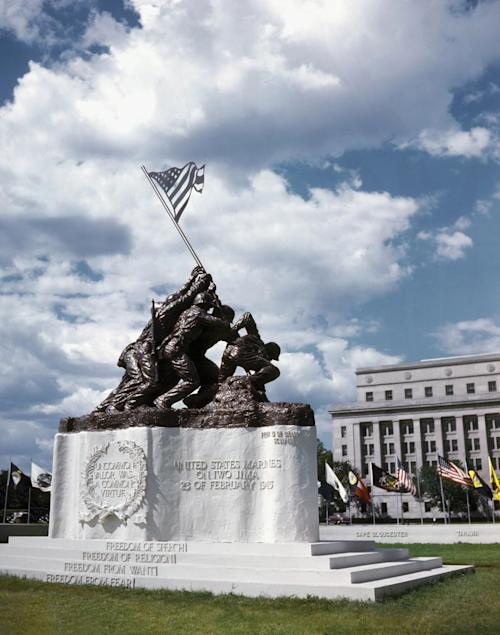 This rare 1945 color photo provided by Rodney Hilton Brown shows the original, smaller 12 1/2-foot (4 meter) cast stone version of Felix de Weldon's iconic statue depicting soldiers raising the U.S. flag at Iwo Jima, in front of the old Navy Department Building, now the Federal Reserve Building, on Constitution Avenue in Washington, D.C. The statue, which was the precursor to de Weldon's much larger bronze Marine Corps War Memorial in Arlington, Va., is expected to fetch up to $1.8 million when it goes on sale at Bonham's auction house in New York on Feb. 22, 2013. Inspired by the Pulitzer Prize winning photo by Associated Press photographer Joe Rosenthal, the stone statue was removed in 1947 and hidden under a tarp at the artist's studio for four decades. (AP Photo/Courtesy of Rodney Hilton Brown)