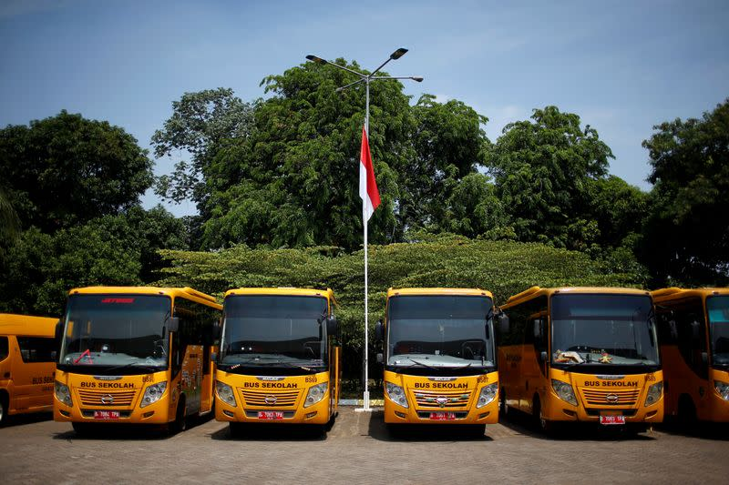 With schools shut, Indonesian bus drivers ferry COVID-19 patients instead