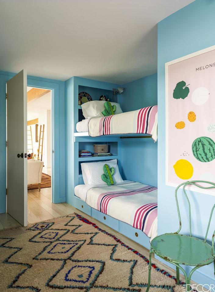 "<p>In this <a href=""https://www.elledecor.com/design-decorate/house-interiors/a8976/marthas-vineyard-vacation-house/"" target=""_blank"">Martha's Vineyard vacation home</a>, an adventurous children's room showcases walls in Benjamin Moore's Fairy Tale Blue.  </p>"