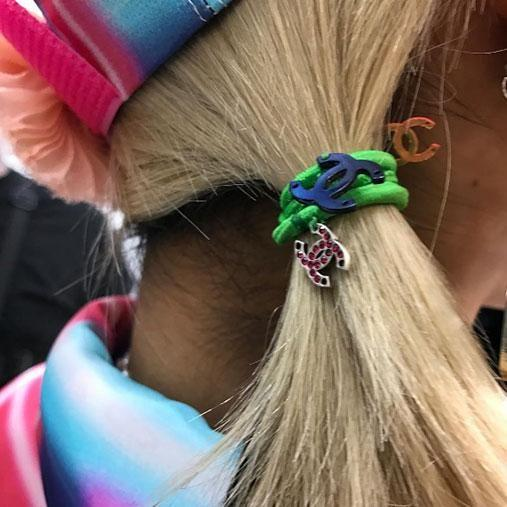 It s all about making a fashion statement with your hair ties this season.  Photo  8c08fd1caa5