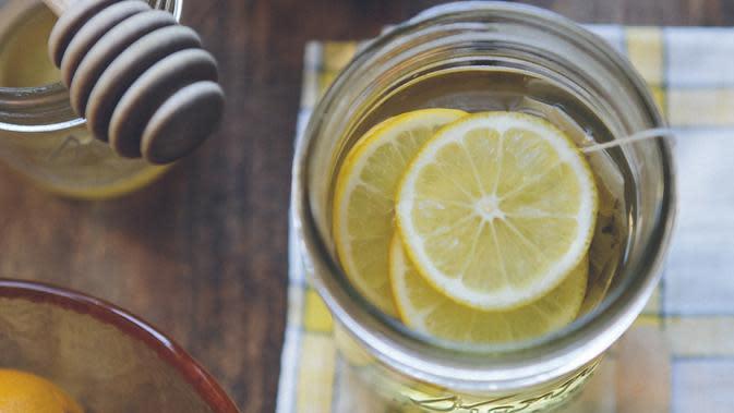Ilustrasi lemon. /copyright unsplash/Anda Ambrosini