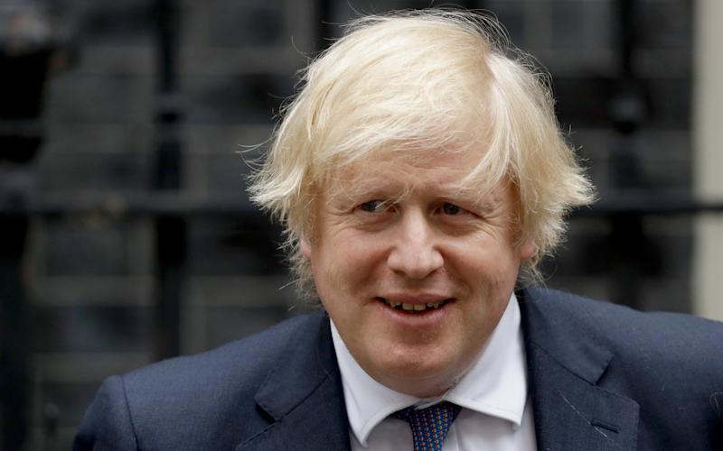 British Prime Minister Boris Johnson leaves 10 Downing Street in London, to attend the weekly Prime Minister's Questions at the Houses of Parliament - AP