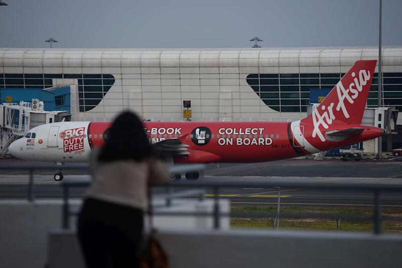An AirAsia plane is pictured on the tarmac at the Kuala Lumpur International Airport in Sepang August 20, 2019. — Picture by Miera Zulyana