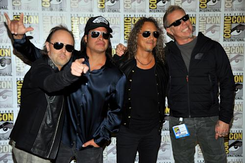 "From left, Lars Ulrich, Robert Trujillo, Kirk Hammett and James Hetfield, of musical Metallica, attend the ""Metallica Through the Never"" press line on Day 3 of Comic-Con International on Friday, July 19, 2103 in San Diego, Calif. (Photo by Chris Pizzello/Invision/AP)"