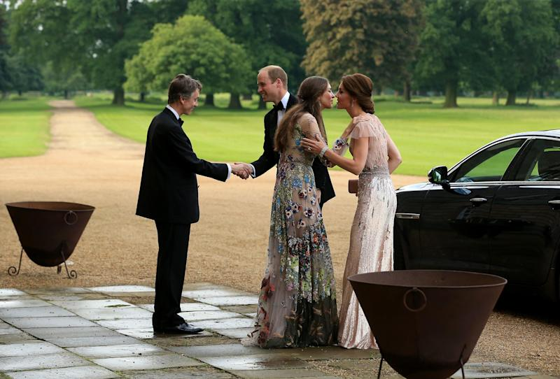 Marquess of Cholmondeley David and wife Rose greet Prince William and Kate