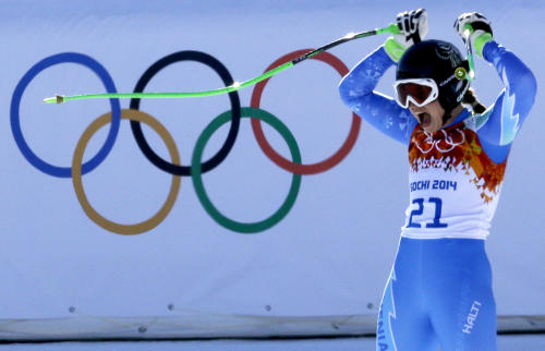 Slovenia's Tina Maze celebrates after finishing the women's downhill, to tie for first place with Switzerland's Dominique Gisin at the Sochi 2014 Winter Olympics, Wednesday, Feb. 12, 2014, in Krasnaya Polyana, Russia. (AP Photo/Kirsty Wigglesworth)