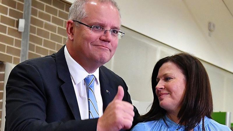 Scott Morrison casts his vote alongside wife Jenny, on election day. Source: AAP