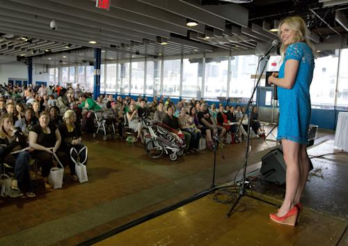 "This May 18, 2013 photo shows pregnancy advise guru Rosie Pope, center, speaks to attendees at the New York Baby Show in New York. Pope is the author of the pregnancy guide, ""Mommy IQ,"" and also has her own maternity clothing line. (AP Photo/Richard Drew, file)"