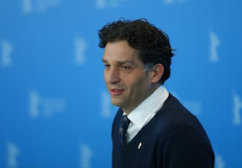 Director Danis Tanovic poses at the photo call of the film An Episode in the Life of an Iron Picker at the 63rd edition of the Berlinale, International Film Festival in Berlin, Wednesday, Feb. 13, 2013. (AP Photo/Markus Schreiber)