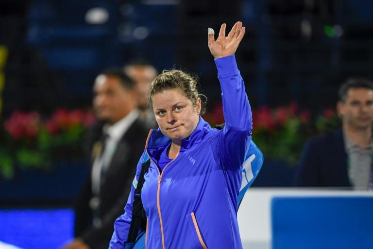 Kim Clijsters waved goodbye to the WTA event in Dubai following first round defeat to Garbine Muguruza