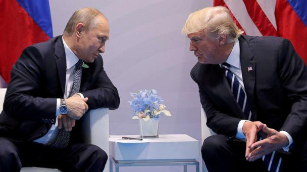 PHOTO: FILE PHOTO: Russia's President Vladimir Putin talks to U.S. President Donald Trump during their bilateral meeting at the G20 summit in Hamburg, Germany, July 7, 2017. (Carlos Barria/Reuters/File)