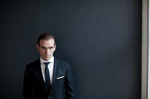 """This 2012 portrait provided by Arielle Doneson shows tenor Michael Fabiano in New York. On Monday, April 8, 2013, Fabiano will make his highest-profile New York appearance yet, singing the role of Oronte in Verdi's """"I Lombardi"""" in concert with the Opera Orchestra of New York at Lincoln Center's Avery Fisher Hall. Fabiano will be rememberd by music lovers who have seen """"The Audition,"""" the documentary about a vocal competition at the Metropolitan Opera, as the dark, almost brooding presence who stands out in sharp contrast to his chipper, smiling fellow contestants. (AP Photo/Arielle Doneson)"""