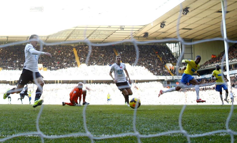 Newcastle United's Remy scores against Tottenham Hotspur during their English Premier League soccer match at White Hart Lane in London