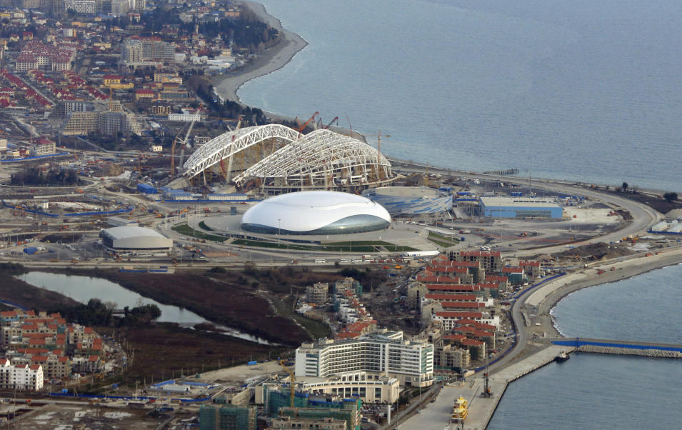 FOR STORY RUSSIA SOCHI YEAR TO GO -  In this photo dated Monday, Feb. 4, 2013, an aerial view of the Olympic Park as construction works continue in the lead up to the upcoming winter games in Sochi, Russia. With just one year till the opening ceremony of the winter Olympic 2014 Sochi Games, the Black Sea resort of Sochi is a vast construction site sprawling for nearly 40 kilometers (25 miles) along the coast and 50 kilometers (30 miles) up into the mountains, with no escape from the clang and clatter of the construction works, the drilling, jack-hammering and mixing of cement. (AP Photo/Dmitry Lovetsky)