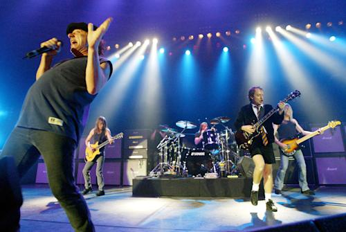 "FILE - This June 17, 2003 file photo shows British rock band AC/DC, from left, Brian Johnson, Malcolm Young, Phil Rudd, Angus Young, and Cliff Williams performing on stage during a concert in Munich, southern Germany. Malcolm Young of AC/DC is taking a break from the band to focus on his health. The band posted on its Facebook page Wednesday, April 16, 2014, that the 61-year-old guitarist is halting from the band ""due to ill health"" after 40 years (AP Photo/Jan Pitman, File)"