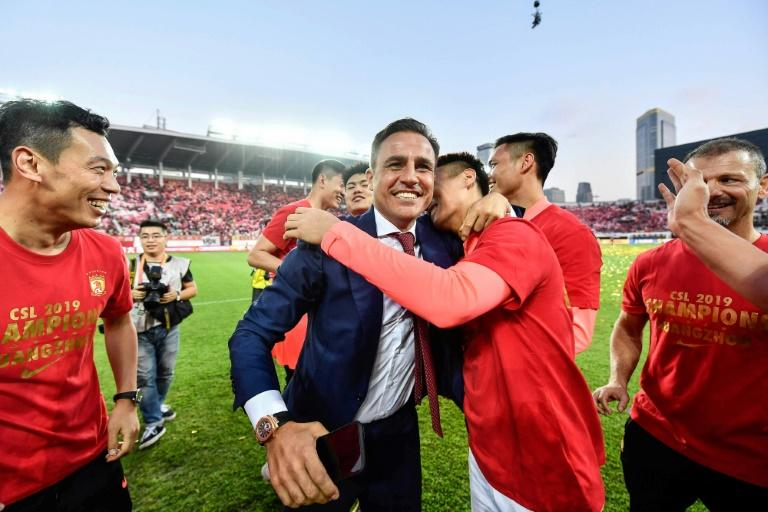 Fabio Cannavaro celebrates his side's CSL title after a turbulent season for the Italian