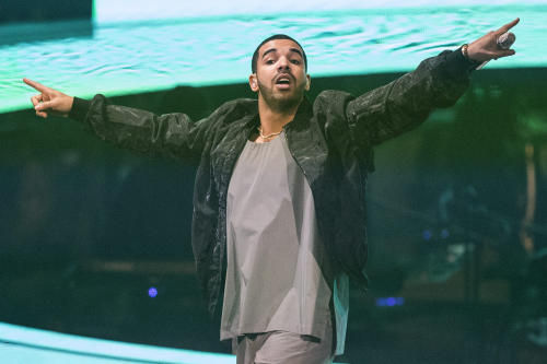 """FILE - In this Oct. 24, 2013 file photo, Drake performs during his """"Would You Like A Tour"""" show in Toronto. Sometimes a song hits you at the right time and place in life, becomes a part of the soundtrack for your list of moments. Drake's """"Started from the Bottom"""" is one of these songs. (AP Photo/The Canadian Press,Chris Young, File)"""