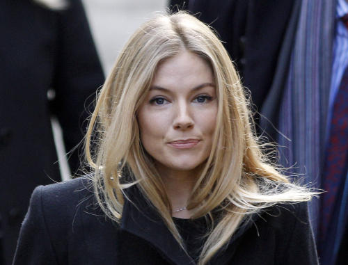 British actress Sienna Miller, arrives to testify at the Leveson inquiry at the Royal Courts of Justice in central London, Thursday, Nov. 24, 2011. The Leveson inquiry is Britain's media ethics probe that was set up in the wake of the scandal over phone hacking at Rupert Murdoch's News of the World, which was shut in July after it became clear that the tabloid had systematically broken the law. (AP Photo/Lefteris Pitarakis)