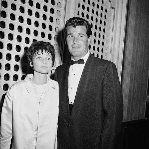 "FILE - Jim Garner of the TV program ?Maverick? arrives with his wife Lois Clarke at the Emmy Awards, in this April 15, 1958 file photo taken in Hollywood, Los Angeles, Calif. Actor James Garner, wisecracking star of TV's ""Maverick"" who went on to a long career on both small and big screen, died Saturday July 19, 2014 according to Los angeles police. He was 86. (AP Photo/File)"