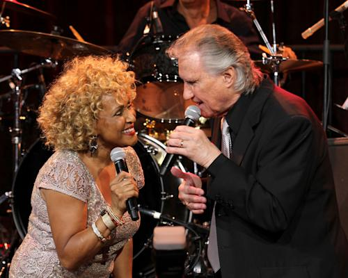 "Singers Darlene Love and Bill Medley perform at the ""Right To Rock Benefit"" at Cipriani Wall Street, on Thursday, Oct. 17, 2013 in New York. (Photo by Greg Allen/Invision/AP)"