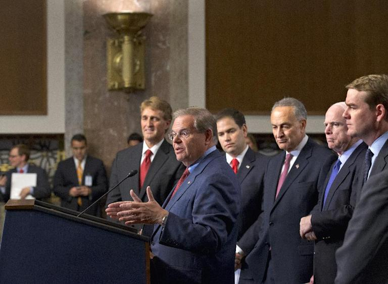 """Foreign Relations Committee Chairman Sen. Robert Menendez, D-N.J., at podium, about immigration reform legislation outlined by the Senate's bipartisan """"Gang of Eight"""" Thursday, April 18, 2013, during a news conference on Capitol Hill in Washington. From left are Sen. Jeff Flake, R-Ariz., Menendez, Sen. Marco Rubio, R-Fla., Sen. Charles Schumer, D-N.Y., Sen. John McCain, R-Ariz., and Sen. Michael Bennet, D-Colo. (AP Photo/J. Scott Applewhite)"""