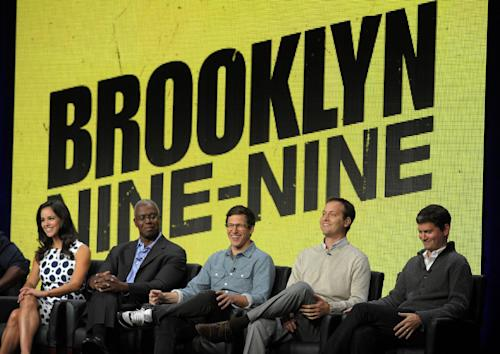 "FILE - In this Aug. 1, 2013 file photo, from left, ""Brooklyn Nine-Nine"" cast members Melissa Fumero, Andre Braugher and Andy Samberg, and co-creators/executive producers Dan Goor and Michael Schur take part in a panel discussion on the series during the FOX 2013 Summer TCA press tour at the Beverly Hilton Hotel, in Beverly Hills, Calif. Fox says the plum post-Super Bowl slot next February will be filled by two of its comedies. ""New Girl"" and freshman series ""Brooklyn Nine-Nine"" will air on Fox after the game that's typically TV's most-watched program and a big promotional platform for other network fare. (Photo by Chris Pizzello/Invision/AP, File)"